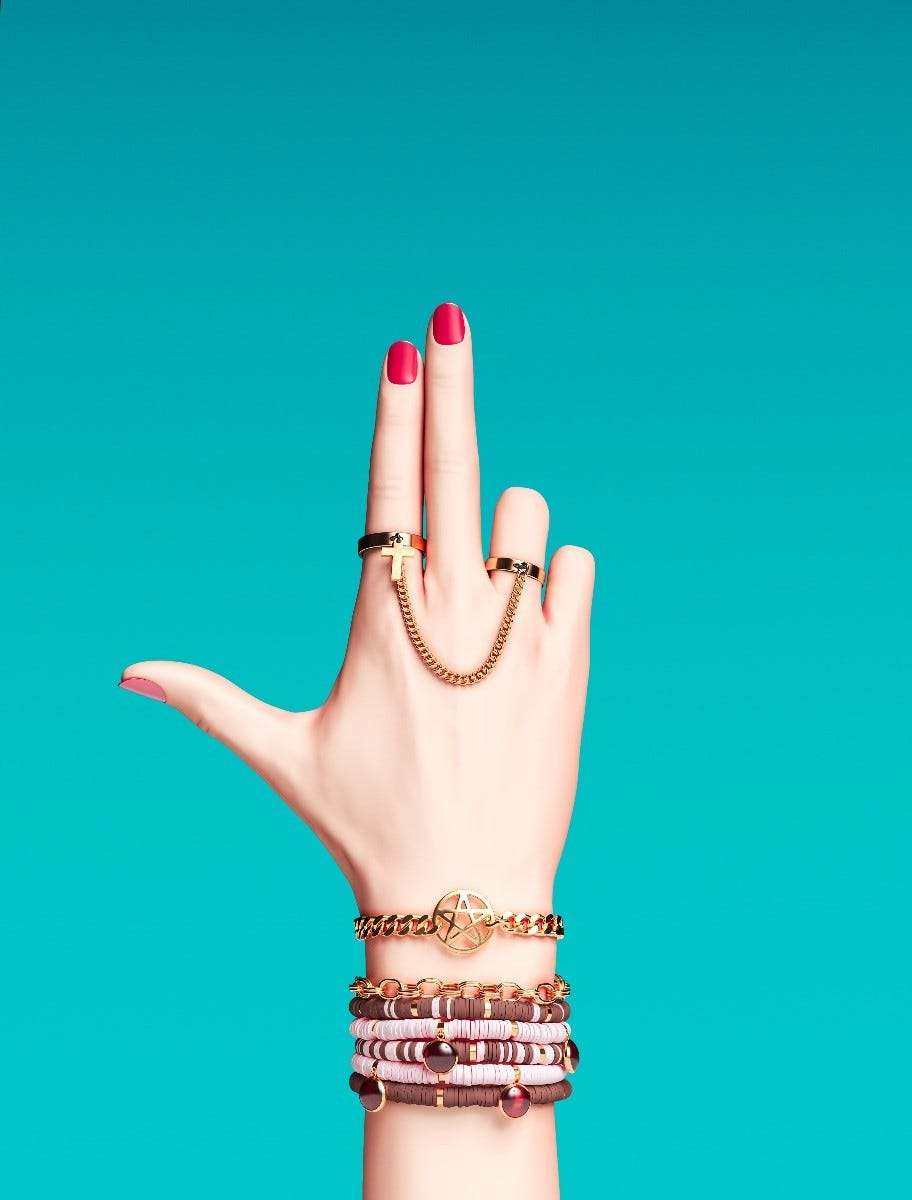 A woman's hand shaped in a finger bang motion